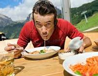 cyclist eating pasta